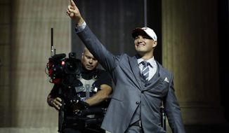 North Carolina's Mitch Trubisky reacts after being selected by the Chicago Bears during the first round of the 2017 NFL football draft, Thursday, April 27, 2017, in Philadelphia. (AP Photo/Matt Rourke)