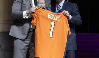 Utah's Garett Bolles, left, and son, Kingston, pose with NFL commissioner Roger Goodell after being selected by the Denver Broncos during the first round of the 2017 NFL football draft, Thursday, April 27, 2017, in Philadelphia. (AP Photo/Matt Rourke)