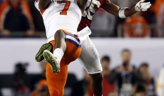 FILE - This Jan. 10, 2017, file photo shows Clemson's Mike Williams catching a pass in front of Alabama's Marlon Humphrey during the second half of the NCAA college football playoff championship game in Tampa, Fla. The NFL Draft will be held April 27-29, 2017, in Philadelphia. (AP Photo/John Bazemore, File)