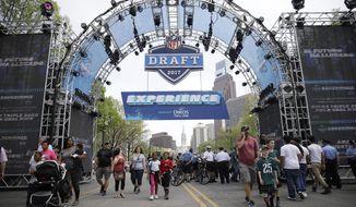 Fans arrive ahead of the 2017 NFL football draft in Philadelphia, Thursday, April 27, 2017. (AP Photo/Matt Rourke)
