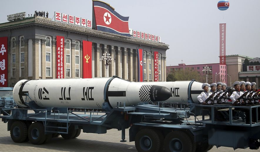 FILE - In this Saturday, April 15, 2017, file photo, a submarine-launched ballistic missile is displayed in Kim Il Sung Square during a military parade in Pyongyang, North Korea, to celebrate the 105th birth anniversary of Kim Il Sung, the country's late founder and grandfather of current ruler Kim Jong Un. North Korea observers have long marveled at the ability of a small, impoverished, autocratic nation to go toe-to-toe with the world's superpowers. (AP Photo/Wong Maye-E, File)