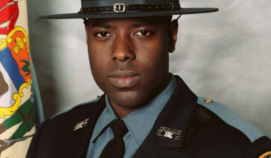 This undated photo released by the  Delaware State Police shows Cpl. Stephen J. Ballard, who was killed in a shooting at a convenience store parking lot near Bear, Del. on Wednesday, April 26, 2017. Police say the man who shot him was killed by law enforcement on Thursday, April 27, 2017, after a 20-hour standoff. (Delaware State Police via AP)
