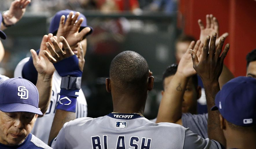 San Diego Padres' Jabari Blash celebrates his run scored against the Arizona Diamondbacks with teammates in the dugout during the fourth inning of a baseball game, Wednesday, April 26, 2017, in Phoenix. (AP Photo/Ross D. Franklin)