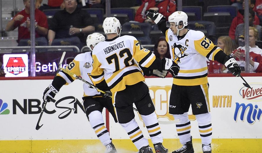 Pittsburgh Penguins center Sidney Crosby (87) celebrates his goal with Patric Hornqvist (72), of Sweden, and Jake Guentzel (59) during the second period of Game 1 of an NHL hockey Stanley Cup second-round playoff series against the Washington Capitals, Thursday, April 27, 2017, in Washington. (AP Photo/Nick Wass)