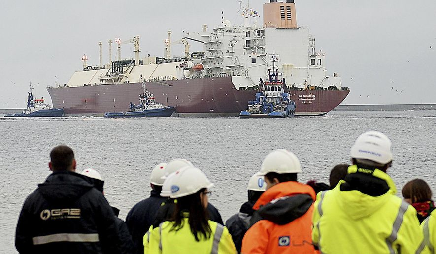 In this file photo taken Dec. 11, 2015 at the Baltic port of Swinoujscie, Poland, the giant liquefied natural gas tanker Al Nuaman, carrying some 200,000 cubic meters of liquefied gas from Qatar, arrives in Swonoujscie, the first delivery to the freshly-built LNG terminal, as Poland seeks to cut its dependence on gas deliveries from Russia. Poland's officials said Thursday, April 27, 2017, the country has just signed its first purchase of LNG from a U.S. supplier. (AP Photo/ Lukasz Szelemej, file)