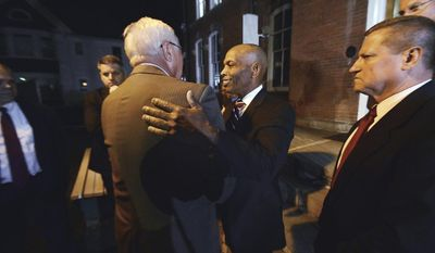 Pennsylvania State Police Commissioner Col. Tyree Blocker, right, and former Pennsylvania State Police Commissioner Frank Noonan embrace after convicted cop killer Eric Frein was sentenced to death late Wednesday, April 26, 2017, at the Pike County Courthouse in Milford, Pa. (Butch Comegys/The Times & Tribune via AP)