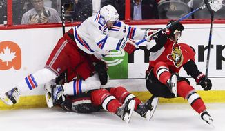 New York Rangers right wing Kevin Hayes (13) runs over Ottawa Senators defenseman Ben Harpur as he checks Senators center Kyle Turris, right, during the second period of Game 1 of an NHL hockey second-round playoff series, Thursday, April 27, 2017, in Ottawa, Ontario. (Sean Kilpatrick/The Canadian Press via AP)