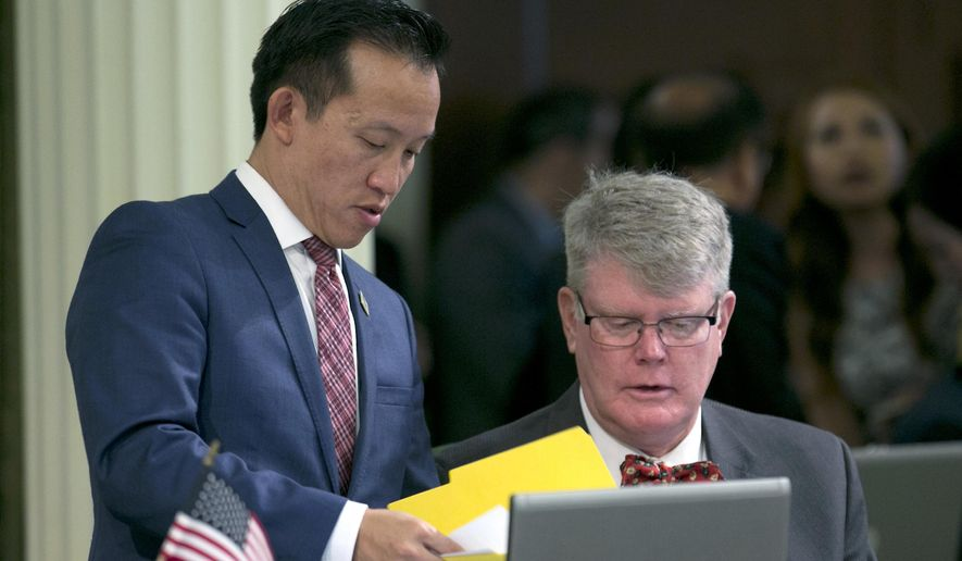 Assemblyman David Chu, D-San Francisco, left, talks with Assemblyman Mark Stone, D-Scotts Valley, after the Assembly unanimously passed Chiu's rape kit bill Thursday, April 27, 2017, in Sacramento, Calif. If approved by the Senate and signed by the governor, Chiu's measure, AB41, would require police departments to track the status of rape kits in an effort to reduce the backlog of untested evidence.(AP Photo/Rich Pedroncelli)