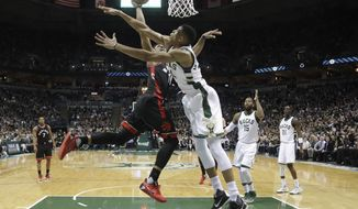 Toronto Raptors' DeMar DeRozan tries to shoot past Milwaukee Bucks' Giannis Antetokounmpo during the first half of Game 6 of an NBA first-round playoff series basketball game Thursday, April 27, 2017, in Milwaukee. (AP Photo/Morry Gash)