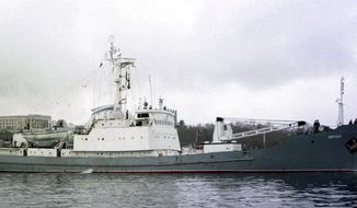FILE - In this file photo taken on Friday, April 2, 1999, Russian Navy reconnaissance frigate Liman leaves from the Russian Black Sea fleet's base at Sevastopol, Crimean peninsula.  Russia's Defense Ministry reported Thursday April 27, 2017, that the Liman naval reconnaissance ship has collided with another ship about 40 kilometers (25 miles) northwest of the Bosphorus Strait, and is in danger of sinking in the Black Sea. (AP Photo/Efrem Lukatsky, FILE)
