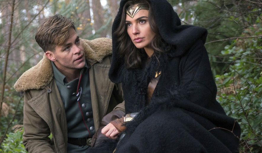 """This image released by Warner Bros. Pictures shows Chris Pine, left, and Gal Gadot in a scene from, """"Wonder Woman."""" The film, directed by Patty Jenkins, opens June 2. (Clay Enos/Warner Bros. Pictures via AP)"""