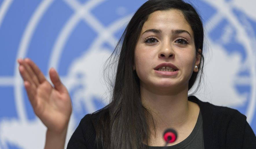 Syrian refugee and Olympic athlete Yusra Mardini, newly appointed UNHCR's Goodwill Ambassador, speaks to the media about her appointment as UNHCR's Goodwill Ambassador, during a press conference, at the European headquarters of the United Nations in Geneva, Switzerland, Thursday, April 27, 2017. (Martial Trezzini/Keystone via AP)