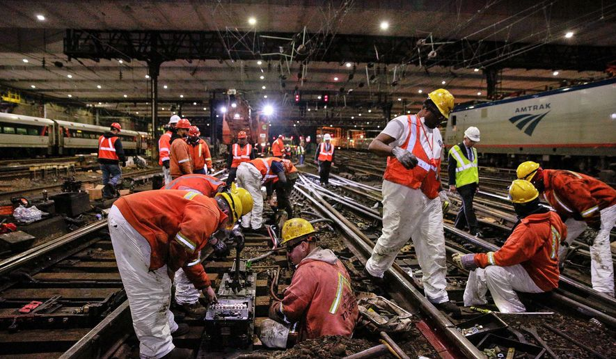 In this April 6, 2017 photo provided by Amtrak, Amtrak workers do repairs on railroad tracks in a tunnel at New York's Penn Station. Amtrak officials said on Thursday, April 27, 2017 that necessary work on tracks and signals at New York's Pennsylvania Station will begin in May and continue through the summer. Rail travelers who have endured major disruptions recently at the nation's busiest rail station are likely to see more delays this summer because New York's Penn Station is in dire need of repair work. (Amtrak via AP)