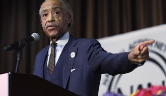 The Rev. Al Sharpton points to Omarosa Manigault, assistant to President Donald Trump & Director of Communications for the Office of Public Liaison, as he delivers his remarks during the Women's Power Luncheon of the 2017 National Action Network convention, in New York, Thursday, April 27, 2017. (AP Photo/Richard Drew)