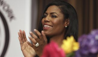 """Omarosa Manigault, political aide and communications director for the Office of Public Liaison at the White House under President Donald Trump's administration, appears at the Women's Power Luncheon of the 2017 National Action Network convention, in New York, Thursday, April 27, 2017. Manigault was a contestant on Trump's reality competition series, """"The Apprentice."""" (AP Photo/Richard Drew)"""