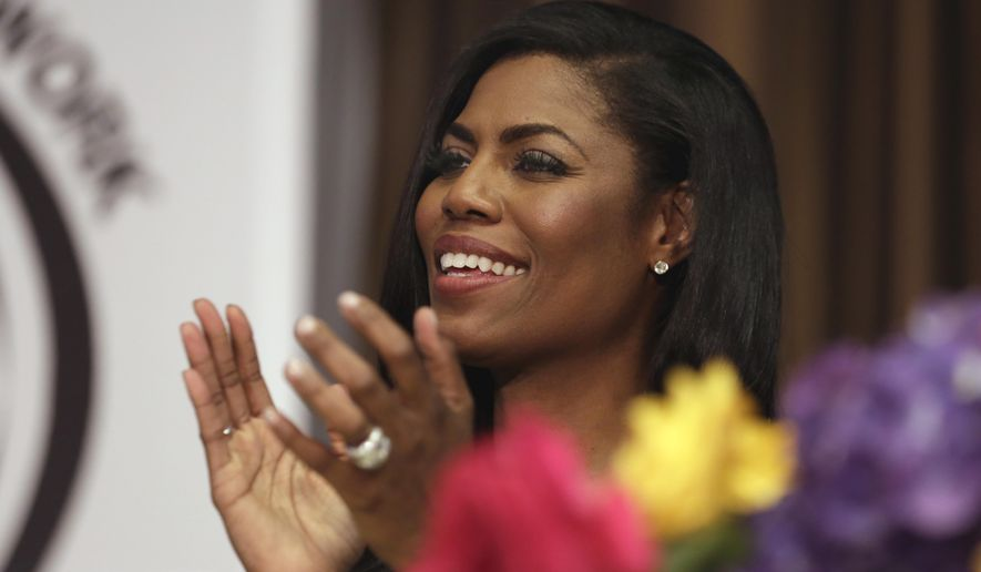 "Omarosa Manigault, political aide and communications director for the Office of Public Liaison at the White House under President Donald Trump's administration, appears at the Women's Power Luncheon of the 2017 National Action Network convention, in New York, Thursday, April 27, 2017. Manigault was a contestant on Trump's reality competition series, ""The Apprentice."" (AP Photo/Richard Drew)"