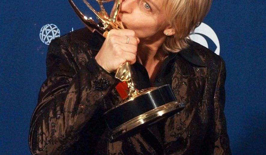 "FILE - In this Sept. 14, 1997 file photo, Ellen DeGeneres kisses her Emmy backstage at the 49th Annual Primetime Emmy Awards in Pasadena, Calif. DeGeneres won the Emmy for outstanding writing in a comedy series for ""Ellen."" It was 20 years ago that Ellen DeGeneres made history as the first prime-time lead on network TV to come out of the closet. The episode was watched by a staggering 44 million viewers. It won an Emmy for writing, a Peabody as a landmark in broadcasting and numerous other accolades. (AP Photo/Kevork Djanzezian, File)"