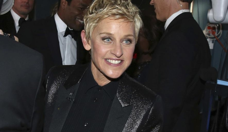 FILE - In this March 2, 2014 file photo, Ellen DeGeneres appears backstage during the Oscars in Los Angeles. DeGeneres made history 20 years ago as the first prime-time lead on network TV to come out, capturing the hearts of supporters gay and straight amid a swirl of hate mail, death threats and, ultimately, dark times on and off the screen. (Photo by Matt Sayles/Invision/AP, File)