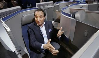 """FILE - In this Thursday, June 2, 2016, file photo, United Airlines CEO Oscar Munoz speaks during an interview in New York, while seated in the seating configuration of the carrier's new Polaris service. United Airlines says it will raise the limit to $10,000 on payments to customers who give up seats on oversold flights and will increase training for employees as it deals with fallout from the video of a passenger being violently dragged from his seat. Munoz said his response, in which he blamed the passenger and supported his employees, was """"insensitive beyond belief."""" (AP Photo/Richard Drew, File)"""