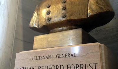 FILE - In this Wednesday, June 24, 2015 photo, a bust of Nathan Bedford Forrest, a Confederate general and early leader of the Ku Klux Klan, sits inside the Capitol in Nashville, Tenn.  Lawmakers in Tennessee say they were tricked into voting for a resolution honoring Forrest, and they're denouncing it. Democratic Rep. Antonio Parkinson of Memphis told his House colleagues Thursday, April 27, 2017, it was unfair to include the resolution honoring Forrest among a slew of uncontroversial measures. (Dave Boucher/The Tennessean via AP, File)