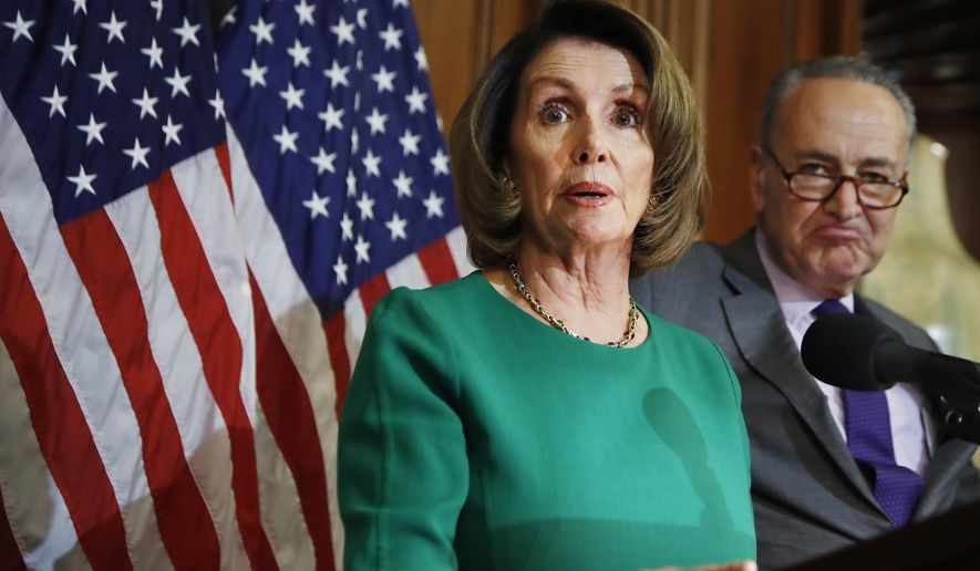House Minority Leader Nancy Pelosi of Calif. with Senate Minority Leader Charles Schumer of N.Y. speaks to reporters about President Donald Trump's first 100 days on April 28, 2017, during a news conference on Capitol Hill in Washington. (Associated Press) **FILE**