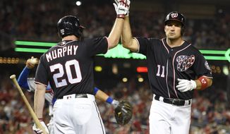 Washington Nationals' Ryan Zimmerman celebrates his two-run home run with Daniel Murphy (20) during the eighth inning of a baseball game against the New York Mets, Friday, April 28, 2017, in Washington. (AP Photo/Nick Wass)