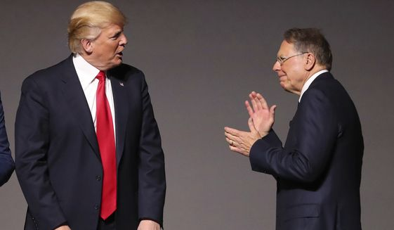 National Rifle Association Executive Vice President Wayne LaPierre welcomed President Trump to the NRA Leadership Forum on Friday. (Associated Press)