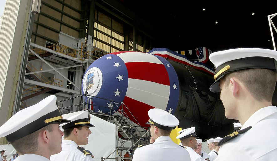 Crew members of the Virginia-class submarine USS Indiana get ready for christening ceremonies Friday April 28, 2017 at Newport News Shipbuilding in Newport News, Va. The ship will be christened Saturday with a crowd of about 4000 expected along with Vice President Mike Pence. (Rob Ostermaier/The Daily Press via AP)