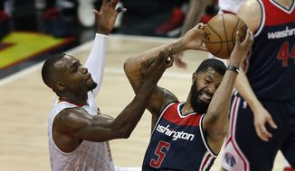 Washington Wizards forward Markieff Morris (5) battles Atlanta Hawks guard Tim Hardaway Jr. (10) for a rebound in the second half of Game 6 of a first-round NBA playoff basketball series Friday, April 28, 2017, in Atlanta. (AP Photo/John Bazemore)