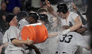 New York Yankees left fielder Matt Holliday, right, celebrates with teammates after hitting a three-run home run to win the game against the Baltimore Orioles in the 10th inning of a baseball game, Friday, April 28, 2017, in New York. (AP Photo/Julie Jacobson)