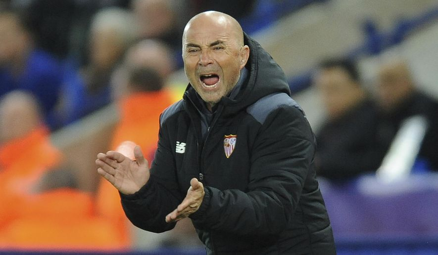FILE - In this March 14, 2017 file photo, Sevilla's head coach Jorge Sampaoli shouts to his team during the Champions League round of 16 second leg soccer match between Leicester City and Sevilla at the King Power Stadium in Leicester, England. Argentine Football Association president Claudio Tapia has said that Sampaoli is his choice to lead Argentina's national team. (AP Photo/Rui Vieira, File)