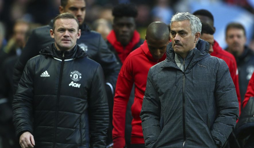 Manchester United's team manager Jose Mourinho, right, and Manchester United's Wayne Rooney, left, arrive for the English Premier League soccer match between Manchester City and Manchester United at the Etihad Stadium in Manchester, Thursday, April 27, 2017.(AP Photo/Dave Thompson)