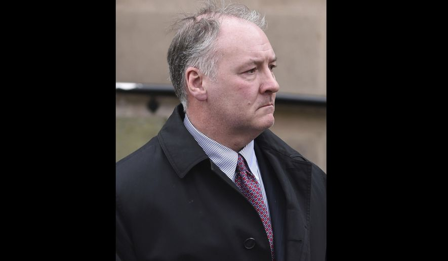 FILE - In this Tuesday Feb. 21, 2017 file photo, former breast surgeon Ian Paterson arrives at Nottingham Crown Court in Nottingham, England. A jury in central England has found a prominent breast surgeon guilty of carrying out unnecessary operations. The Nottingham Crown Court jury found Ian Paterson guilty on Friday, April 28 of 17 counts of wounding with intent to cause grievous bodily harm and three counts of unlawful wounding. Prosecutors say the 59-year-old doctor lied to patients or exaggerated their risk of cancer to persuade them to have surgery. (Joe Giddens/PA via AP, file)