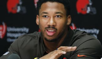 Cleveland Browns' Myles Garrett, selected No. 1 overall in the NFL draft, answers questions during a news conference at the football team's training facility, Friday, April 28, 2017, in Berea, Ohio. Garrett played defensive end at Texas A&M. (AP Photo/Ron Schwane)