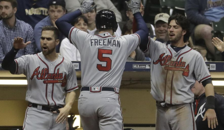 Atlanta Braves' Freddie Freeman is congratulated after hitting a two-run home run during the ninth inning of a baseball game against the Milwaukee Brewers Friday, April 28, 2017, in Milwaukee. (AP Photo/Morry Gash)