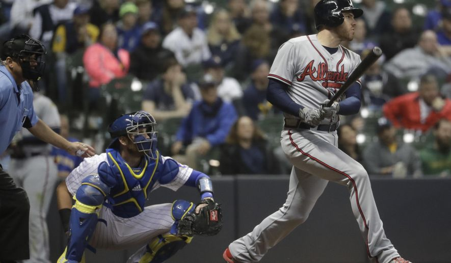 Atlanta Braves' Freddie Freeman hits a two-run home run during the ninth inning of a baseball game against the Milwaukee Brewers Friday, April 28, 2017, in Milwaukee. (AP Photo/Morry Gash)