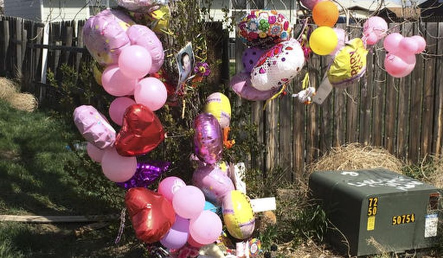 FILE - In This April 22, 2016 file photo a memorial is placed in front of the house for Kenzley Olson in Poplar, Mont. Federal prosecutors say Janelle Red Dog of Poplar, abused Olson, a 13-month-old girl in her care, and used methamphetamine while Olson was unconscious and, when she stopped breathing, put her body in a bag and threw it in a trash can before going home to sleep. Red Dog is scheduled to plead guilty on May 1, 2017 to second-degree murder. (AP Photo/Richard Peterson, File)