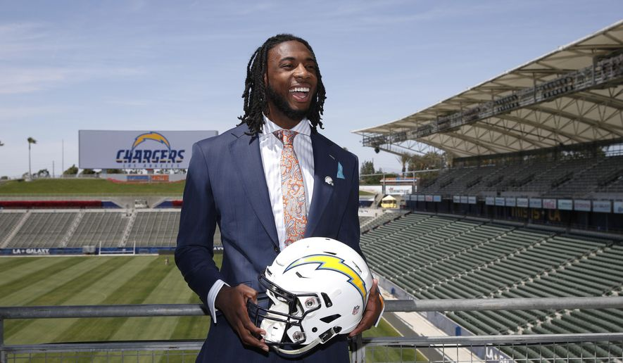 The Los Angeles Chargers' first-round draft pick Mike Williams poses for photos after an NFL football news conference at the StubHub Center, Friday, April 28, 2017, in Carson, Calif. (AP Photo/Jae C. Hong)