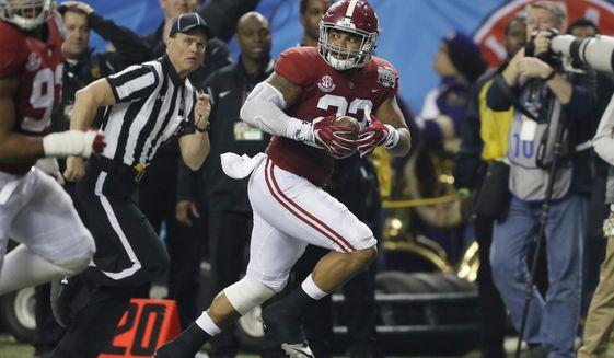 FILE - In this Dec. 31, 2016, file photo, Alabama linebacker Ryan Anderson (22) runs toward the end zone for a touchdown against Washington after an interception during the Peach Bowl NCAA college football playoff game in Atlanta. The Washington Redskins selected Anderson in the NFL draft Friday, April 28. (AP Photo/John Bazemore, File)