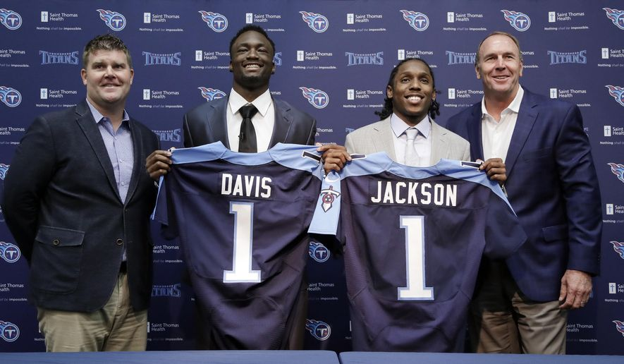 Western Michigan wide receiver Corey Davis, second from left, and Southern California defensive back Adoree' Jackson, second from right, pose with Tennessee Titans general manager Jon Robinson, left, and head coach Mike Mularkey as Davis and Jackson are introduced as the Titans' top draft picks during a news conference Friday, April 28, 2017, in Nashville, Tenn. (AP Photo/Mark Humphrey)