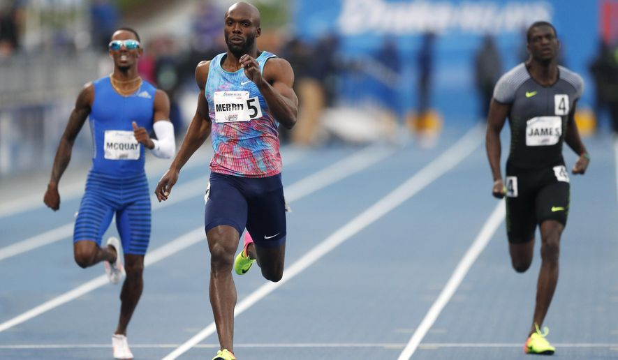 LaShawn Merritt, center, beats Tony McQuay, left, and Kirani James, right, to the finish line to win the men's special 400 meters at the Drake Relays athletics meet, Friday, April 28, 2017, in Des Moines, Iowa. (AP Photo/Charlie Neibergall)