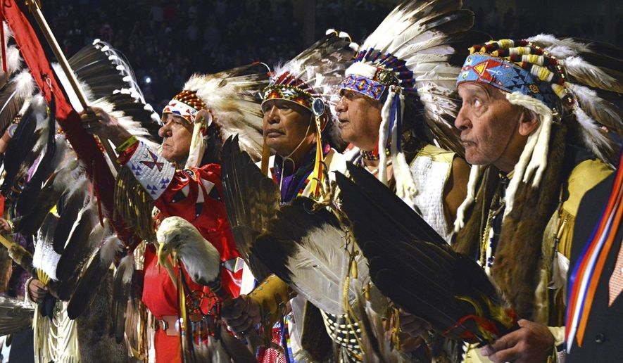 A group of Native American elders lead the grand entry to the Gathering of Nations on Friday, April 28, 2017 in Albuquerque, N.M. The Gathering of Nations, one of North America's most prominent American Indian powwows, is attracting thousands of dancers and as many as 100,000 attendees to New Mexico's largest city this week. (AP Photo/Russell Contreras)