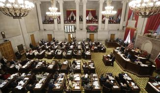 FILE - In this April 18, 2017, file photo, debate on Gov. Bill Haslam's road and bridge funding bill takes place in the House of in Nashville, Tenn. The bill ultimately passed and Haslam signed it into law on April 26, 2017. (AP Photo/Mark Humphrey, File)