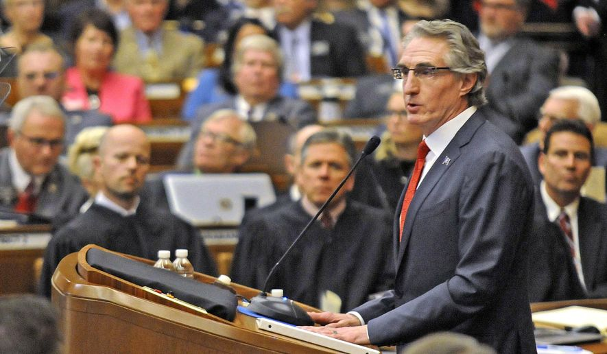 FILE - In this Jan. 3, 2017, file photo, North Dakota Gov. Doug Burgum opens the state's 65th legislative assembly in front of a joint session of the legislature where he delivered the State of the State address in Bismarck, N.D. The North Dakota Legislature completed its session late Thursday, April 27, 2017, adopting a budget that cuts by nearly one-third the amount of state spending amid declining tax revenue from depressed farm and energy prices. (Tom Stromme/The Bismarck Tribune via AP, File)