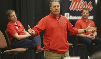 Mississippi football coach Hugh Freeze speaks to the alumni gathered during the Rebel Roadshow as Chancellor Jeff Vitter, left, and Athletic Director Ross Bjork, right, sit nearby, Wednesday evening, April 26, 2017, in Tupelo, Miss. (Lauren Wood/Northeast Mississippi Daily Journal via AP)