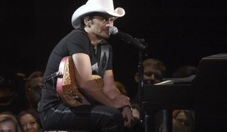 "FILE - In this Nov. 2, 2016 file photo, Brad Paisley performs at the 50th annual CMA Awards in Nashville, Tenn. Paisley's newest album, ""Love and War,"" was released this month. (Photo by Charles Sykes/Invision/AP, File)"