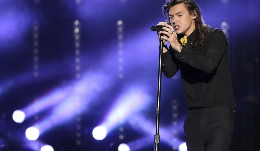 FILE - In this Nov. 22, 2015, file photo, Harry Styles of One Direction performs at the American Music Awards at the Microsoft Theater in Los Angeles. Styles announced a solo world tour on April 28, 2017, ahead of the May 12 release of his self-titled solo debut. (Photo by Matt Sayles/Invision/AP, File)