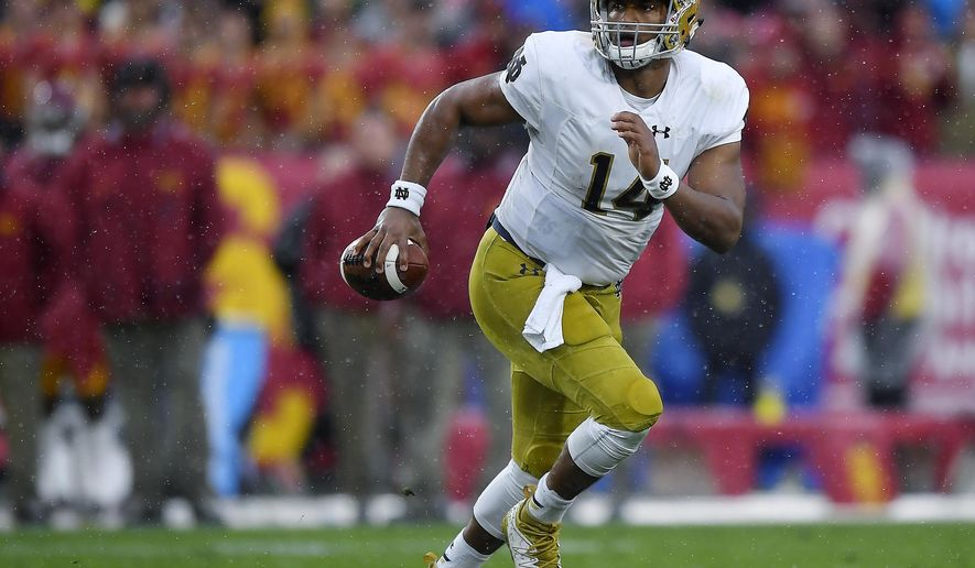 FILE - In this Nov. 26, 2016, file photo, Notre Dame quarterback DeShone Kizer runs the ball during the team's NCAA college football game against Southern California in Los Angeles. The NFL Draft will be held April 27-29, 2017, in Philadelphia.(AP Photo/Mark J. Terrill, File)