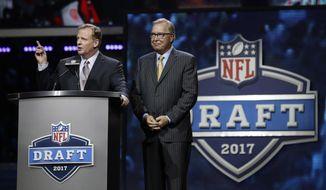 NFL commissioner Roger Goodell, left, speaks with former Philadelphia Eagles' Ron Jaworski before the second round of the 2017 NFL football draft, Friday, April 28, 2017, in Philadelphia. (AP Photo/Matt Rourke) **FILE**