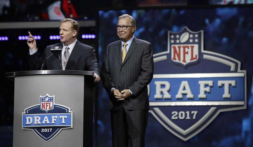 NFL commissioner Roger Goodell, left, speaks with former Philadelphia Eagles' Ron Jaworski before the second round of the 2017 NFL football draft, Friday, April 28, 2017, in Philadelphia. (AP Photo/Matt Rourke) **FILE**
